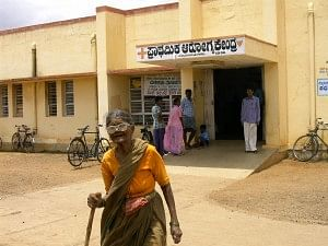 An old woman walks out of the Pattanayakanahalli PHC in Tumkur district of Karnataka. PHCs are the first line health services for most of the rural poor.