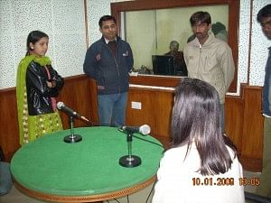 The members of the reporting team in a discussion at Lalit Lokvani, UP's first community radio station.