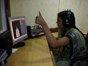 Rachna, 19, on the console recording a programme at the community radio station. (Credit: Anjali Singh\WFS)