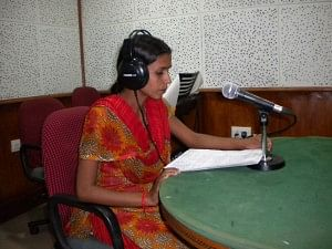 Vidya, a community reporter and an RJ at the community radio anchors a programme for women in Lalitpur. (Credit: Anjali Singh\WFS)