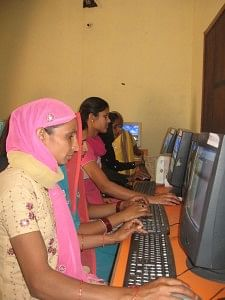 Women working at the computer in the first-of-its-kind women-only rural BPO in India. (Credit: Hemlata Aithani\WFS)