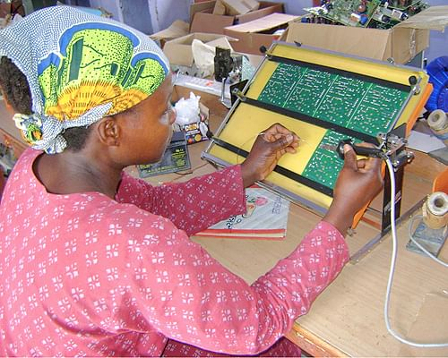 Azouassi Togbe from Benin works on a circuit board