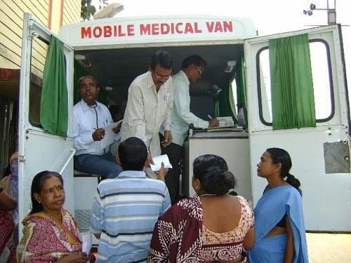 The Community Development Society (CDS) women with patients at the mobile medical van.