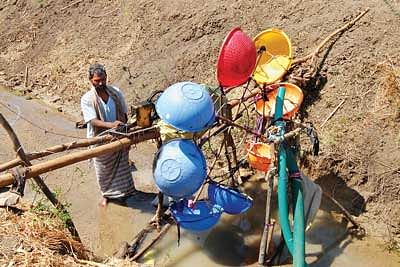 An illiterate Farmer designs a Water Mill to generate Electricity