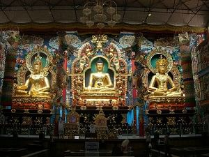 The Lord Buddha, flanked by Lord Padmasambhava and Lord Amitayus on either side.