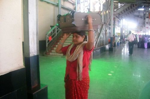 Parasai Sahu, 36, works as a woman porter at the Raipur station in Chhattisgarh.