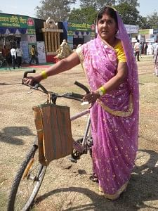 Rajkumari Devi, the 58-year-old mother of three grown up children, cycles through the dusty lanes of the villages in Bihar's Muzzaffarpur district, giving tips to people on kitchen farming and on developing the right agro-based products for business.
