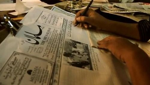A Katib writing the newspaper