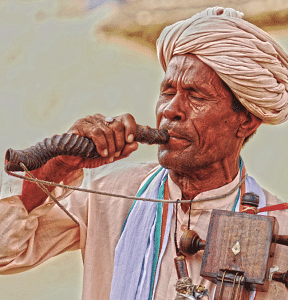 Babunath Jogi, a devotional vocalist, plays the Jogia Sarangi and sings eulogies and folktales with his co-artists Surdas and Mehmood khan who accom- pany with the beats of Bhapang (rare single stringed percussion instrument) and the Dholak.