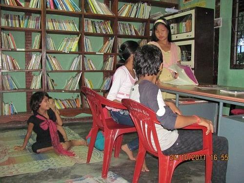 Children inside Bamboosa Library, Tezu