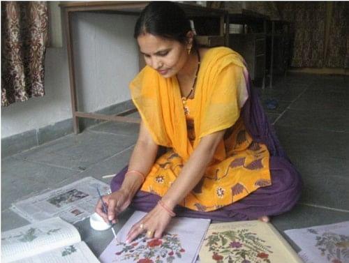 Uma Joshi, 35, of Naugaon village can make an incredible 150 file folders and picture hangings per month. (Credit: Nitin Jugran Bahuguna\WFS)