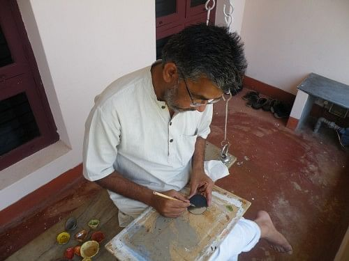 The Artist with his work