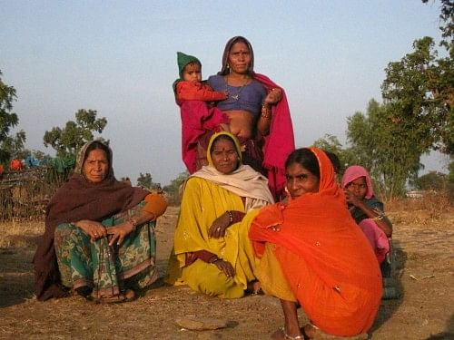 Gyarsi Bai Sahariya along with other women from Sunda village of Kishanganj block in Baran distict of Rajasthan. Together they hope to free the Sahariya families of their curse of starvation. (Credit: Anumeha Yadav\WFS)