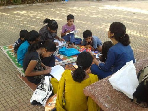 A volunteer teaching children at Carter Road