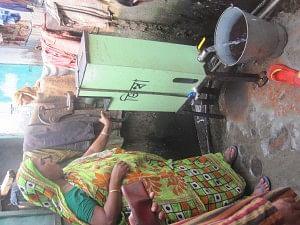 Women in a slum using ZIMBA to get clean water