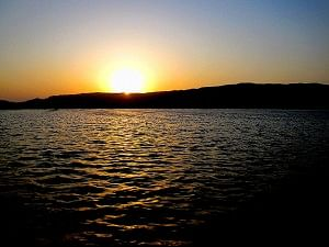 The sun setting on the Anasagar Lake