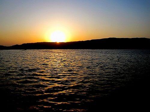 The sun setting on the Anasagar Lake