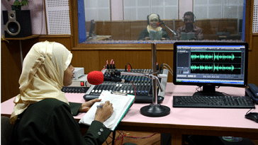 Making waves: A recording in progress, in a community radio station. Community Radio Stations have proved to be vital in imparting skills like scripting, recording and anchoring.