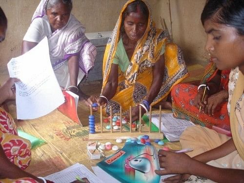 Women using various learning tools to educate themselves. (Credit: Pradan)