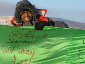 Mr. Sikha with the longest hand-woven silk fabric with messages from various dignitaries, at the North Pole