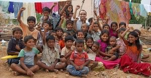 Mr. Satish Sikha with the children after a distribution drive of free biscuits