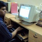 Pradip using the computer with the help of electronic braille reader
