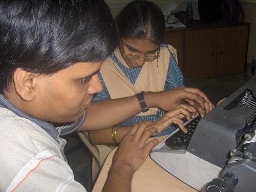 Pradip with his teacher, counsellor and interpretor Devyani Hadkar