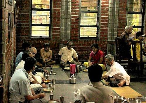 Mealtime at Asha Niketan is a happy affair with the family eating together and sharing jokes and anecdotes.