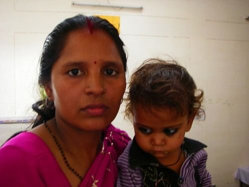 Nirmala with her adopted daughter, Ankita. Nirmala is one of several courageous women in Uttar Pradesh, who fought with her own relatives to save the life of a baby girl.