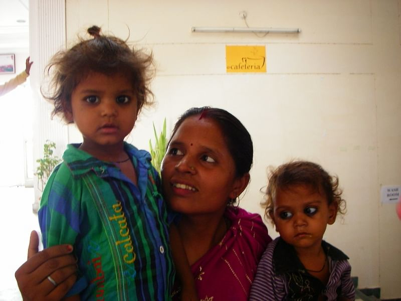 Nirmala, who is mother to five, with her daughters, Anjali and Ankita.