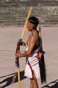 Naga tribesman in traditional attire competing in the archery contest.