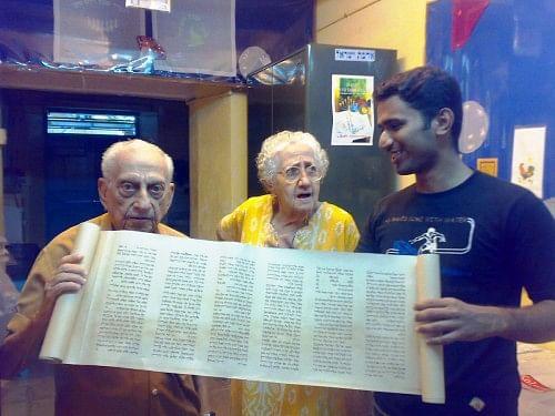 Thoufeek Zakariyah, Sarah Cohen and Isaac Ashkenazi inspecting a Torah that Thoufeek designed.