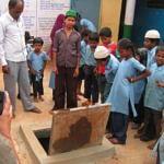 Biome Environmental - Children with the rainwater storage sump