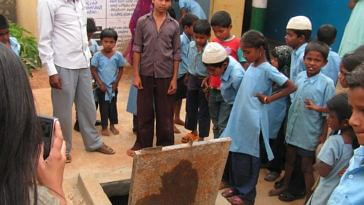 Biome Environmental - Children with the rainwater storage sump