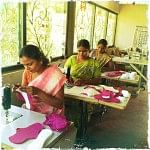 Women stitching the cloth napkins at the facility in Auroville, Pondicherry
