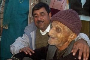 Mr Sharma with an elder in Old Age Home