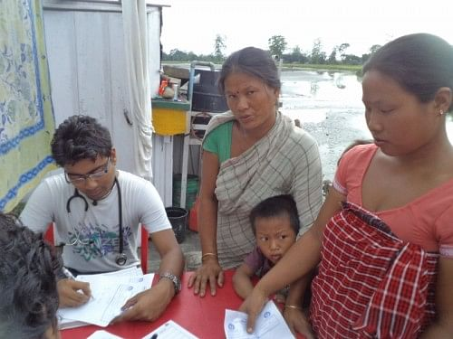 Women consult a doctor atop a boat clinic during one of its visits in Dhubri. (Credit: Azera Rahman\WFS)