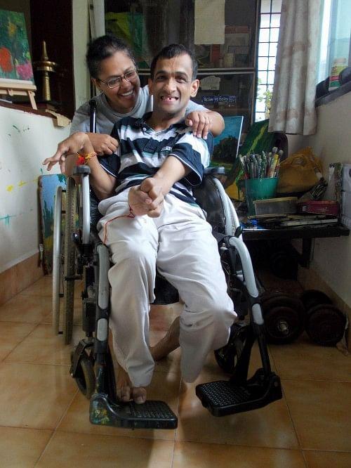 Ramakrishnan with his elder sister Vimala in his balcony, the 'RK Studio'.
