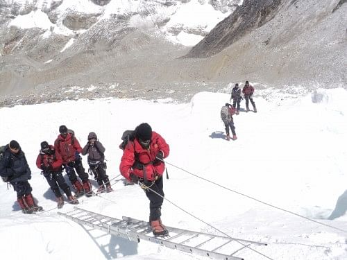 Flight Lieutenant Nivedita Choudhary climbing the ladder at Khmbu icefall during the ascent to Mt Everest. (Credit: Nivedita Choudhary\WFS)