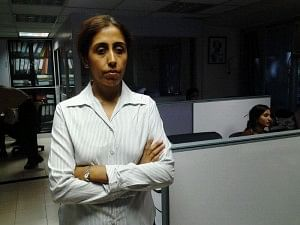 Rohra at her Mumbai work place_ with the portable scan-n-read device.