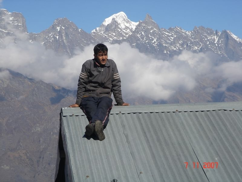 Kitchen staff Lakhpat rests after trekkers have had their morning breakfast