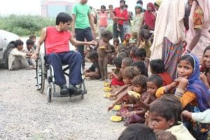 Navin Gulia with some of the street children he supports through his initiative - Apni Duniya Apna Ashiana