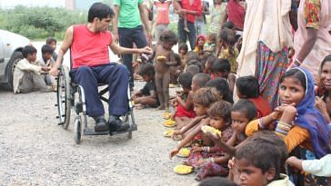Navin Gulia with some of the street children he supports through his initiative - Apni Duniya Apna Ashiana
