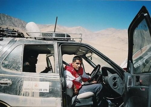 Gulia in the car he created history in and now, on his mission to feed children.