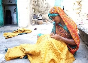 Visit Dilwara around mid-day and chances are that you will find many women sitting in the courtyards of their homes, plying their needle. (Credit: WFS)
