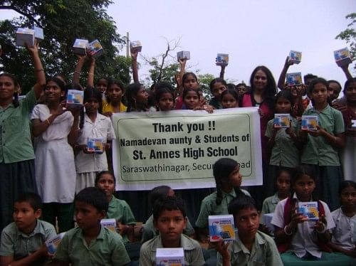 Happy students of a school at Anamalaveedu in Anantapur district after receiving their LED lights.