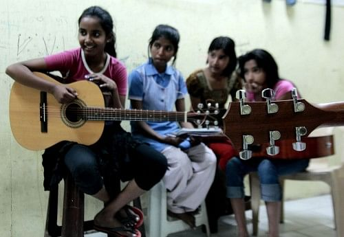 Spending time at Music Basti gives these kids a chance to do something other than study.