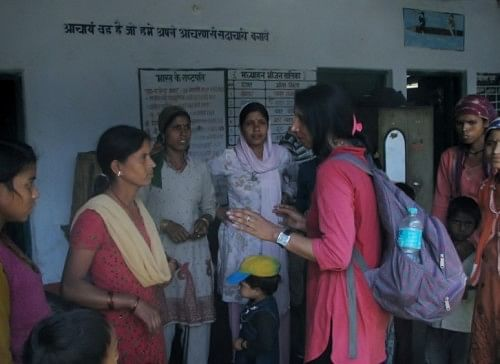 Premlatha  Agarwal, a mountaineer talking to the villagers of New Didasari giving them some hope and courage