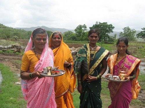 Women celebrating the festival of Vatapoornima in Mogarwadi. They hold fasts and perform poojas for the longetivity of the breadwinners of their families - the farmers working far away in the fields.