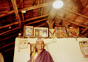 SELCO Solar - Shantavva a freedom fighter appreciates SELCO lights in her home in Dharwad